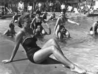 Guests lounge at the pool at the Dolphin Village Hotel in Shavei Zion, 1954 (Source: Wikimedia Commons)