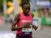 Kenya's Faith Chemaoi crosses the finishing line of the 2014 Paris Marathon (Source: Wikimedia Commons)