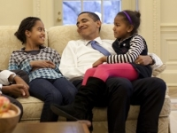 President Barack Obama in the Oval Office with daughters Malia and Sasha, 2009 (Source: Wikimedia Commons)