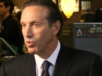 Starbucks Chairman Howard Schultz talks to the media (Source: Wikimedia Commons)