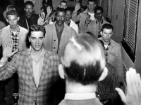 Elvis Presley and others being sworn into the US Army, 1958 (Source: Wikimedia Commons)