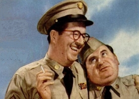 Phil Silvers (Sgt. Bilko) and Maurice Gosfield (Pvt. Doberman), 1956. Photo from Camel advert in Life magazine (Source: Wikimedia Commons)