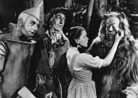 The Wizard of Oz – a publicity still of Jack Haley, Ray Bolger, Judy Garland and Bert Lahr promoting the 1966 CBS broadcast of the 1939 MGM feature film (Source: Wikimedia Commons)