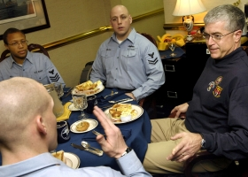 Rear Adm. Daniel Holloway talks with sailors during his weekly Admiral's 'brown bag lunch' aboard aircraft carrier USS Enterprise (Source: Wikipedia Commons)