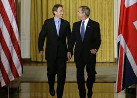 Tony Blair and George W. Bush at the White House, 2003 (Source: Wikimedia Commons)