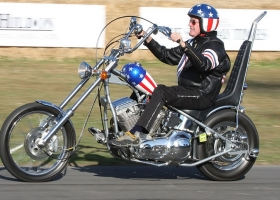 Peter Fonda rides a replica of the 'Captain America' Harley-Davidson used in Easy Rider (Source: Wikimedia Commons)