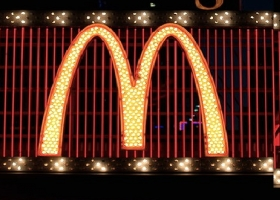 The McDonalds sign in Times Square (Source: Wikimedia Commons)