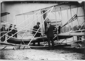 Orville and Wilbur Wright examine canoe fittings before the first flight over water, 1909 (Courtesy: Library of Congress)