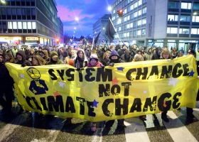 System change not climate change', 2009, UN climate talks in Copenhagen. Photo: kris krüg via Flickr (CC BY-NC-ND).