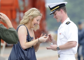 Official U.S. Navy Imagery – a sailor presents his girlfriend with an engagement ring (Source: Wikimedia Commons)