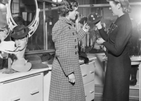Shopping for hats in London,1942 (Source: Wikimedia Commons)
