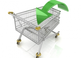 Shopping cart with green arrow